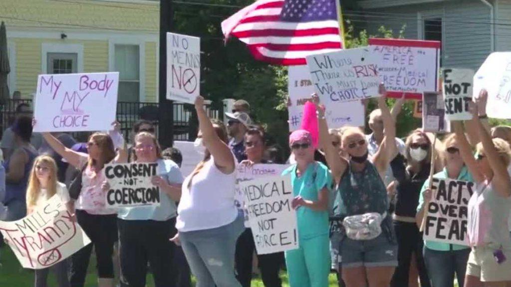 Kantor pemerintah Mills menanggapi protes terhadap vaksin yang diamanatkan untuk petugas kesehatan